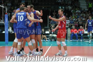 Russian volleyball team celebrates and haves fun in this photo. Enjoy the game!